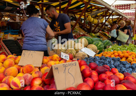 Zadar, Croatia - July 23, 2018: Fruits and vegetables being sold in the market of Zadar old town - Stock Photo