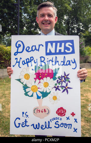 Labour MPs including Jon Ashworth, David Lammy and Dennis Skinner, gather on College Green in Westminster holding cards wishing the NHS a happy 70th Birthday.  Featuring: Jonathan Ashworth MP Shadow Secretary of State for Health Where: London, England, United Kingdom When: 04 Jul 2018 Credit: Wheatley/WENN - Stock Photo