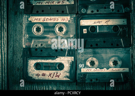 Set of old audio cassettes on wooden table - Stock Photo