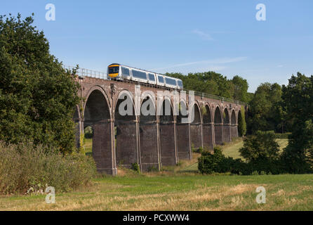 A Chiltern railways class 168 turbostar train crossing  Saunderton Viaduct (south of Banbury) with a London to Birmingham Snow hill express - Stock Photo