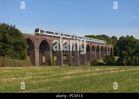 A Chiltern railways class 168 turbostar train crosses  Saunderton Viaduct (south of Banbury) with an express service for Birmingham - Stock Photo