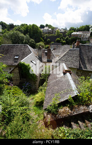 FRANCE, VIGEOIS - JULY 17, 2018: View over the old slated roofs of the medieval village. - Stock Photo