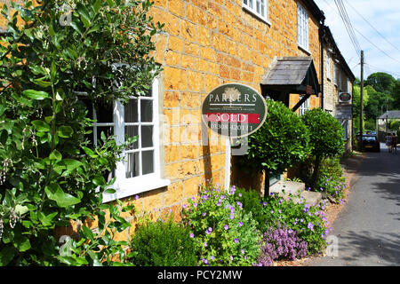 Pretty terraced village cottage which has just been sold, Netherbury, Dorset, UK - John Gollop - Stock Photo