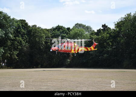 Essex Herts Air Ambulance Helicopter - Stock Photo