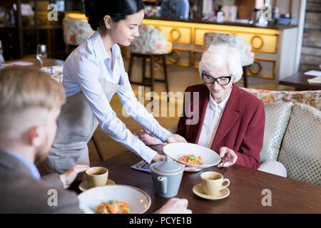 Having lunch at cafe - Stock Photo