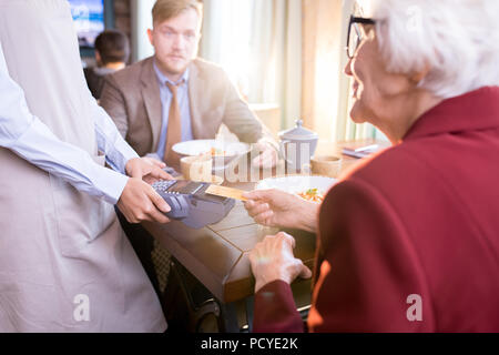 Paying for order with a credit card - Stock Photo