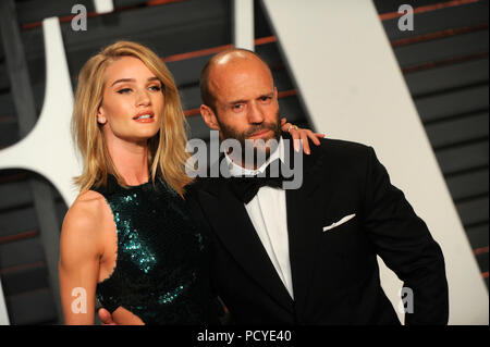 BEVERLY HILLS, CA - FEBRUARY 22:  Natalie Portman attends the 2015 Vanity Fair Oscar Party hosted by Graydon Carter at Wallis Annenberg Center for the Performing Arts on February 22, 2015 in Beverly Hills, California  People:  Rosie Huntington-Whiteley and actor Jason Statham - Stock Photo