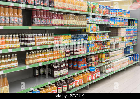 Kiev, Ukraine. July 15 2018. Fruit juices on shelves in a supermarket. Fruit juice consumption overall in Europe. Different juices on the shelf in the - Stock Photo