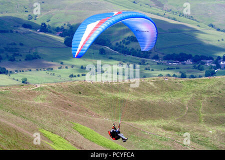 Paragliders and Hang Gliders over Mam Tor - Stock Photo