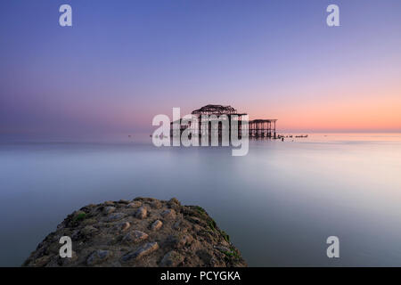 The ruins of the West Pier in Brighton at sunset and a low spring tide