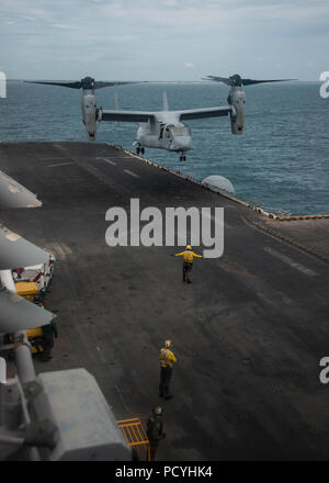 180803-N-ZG607-0025  ATLANTIC OCEAN (Aug. 3, 2018) An MV-22B Osprey, attached to Marine Medium Tiltrotor Squadron (VMM) 162 (Reinforced), prepares to land on the flight deck of the Wasp-class amphibious assault ship USS Iwo Jima (LHD 7), Aug. 3, 2018. Iwo Jima is deployed with its amphibious ready group in support of maritime security operations and theatre security cooperation efforts in Europe and the Middle East. (U.S. Navy photo by Mass Communication Specialist 3rd Class Dominick A. Cremeans/Released) - Stock Photo