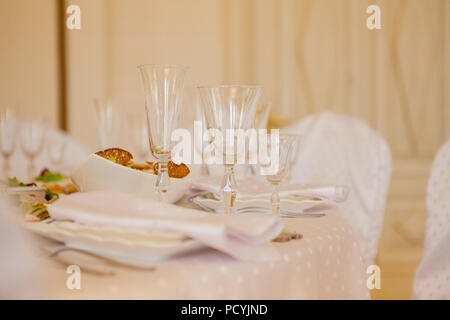 Glasses Flowers Fork Knife Napkin Folded In A Pyramid Served