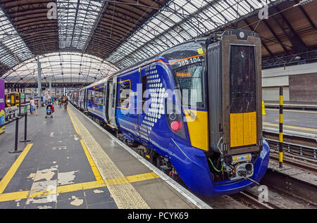 Hitachi made Scotrail new Class 385 Electric Multiple Unit leaving Queen Street Station in Glasgow Scotland UK for Edinburgh - Stock Photo