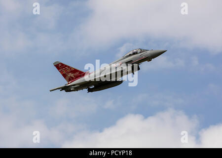 An RAF Typhoon fighter jet in mid flight - Stock Photo