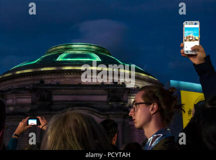 Darkness falls at Edinburgh International Festival opening event as singer waits to perform, Festival Square, Usher Hall, Edinburgh, Scotland, UK - Stock Photo
