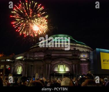 Fireworks over Usher Hall from Edinburgh Military Tattoo as crowd waits for opening event of EIF, Five Telegrams, Edinburgh, Scotland, UK - Stock Photo