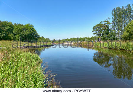 people walking on the tow path on the forth and clyde canal in falkirk in scotland uk - Stock Photo