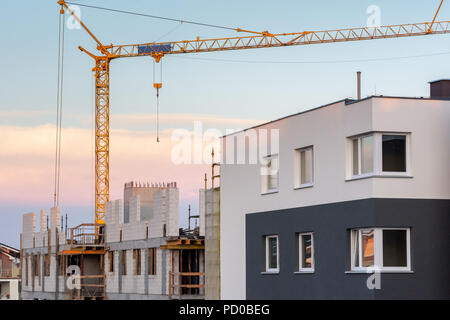 Modern residential building on a construction site. - Stock Photo