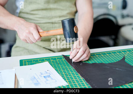 Master working with leather - Stock Photo