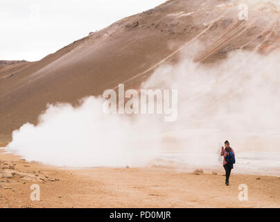 Namafjall geothermal field spewing toxic sulfur fumes in Mt. Námafjall near Mývatn, Iceland - Stock Photo