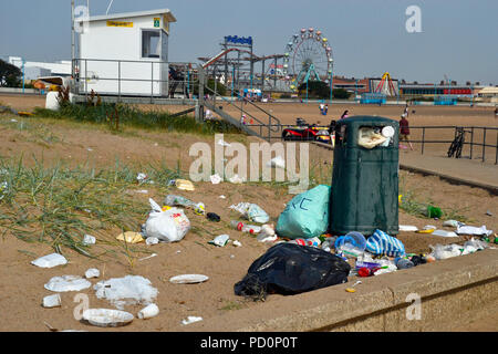 Overflowing rubbish bins and litter on Skegness Beach in Summer 2018. Ocean plastic. England, UK. - Stock Photo