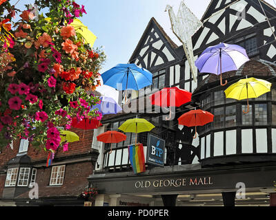 Umbrellas display in Salisbury High Street in Wiltshire, England. - Stock Photo