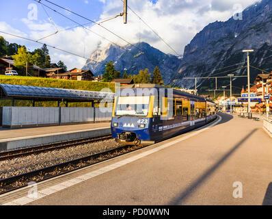 Berner Oberland Bahn (Bernese Oberland Railway) train to Interlaken Ost in Grindelwald station, Bernese Oberland, Switzerland - Stock Photo