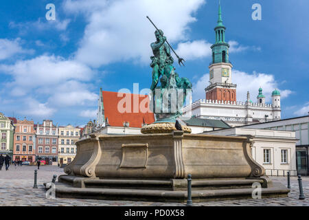 Poznan, Poland - March 30, 2018: Neptune fountain with the city hall tower in the background on the Main Market (Rynek) square in the Old Town of Pozn - Stock Photo