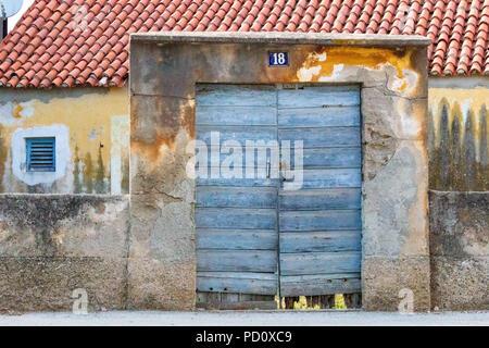 Zadar, Croatia - July 23, 2018: Entrance of a rustic old house in the village of Zaton near Zadar - Stock Photo