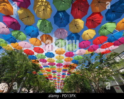 Umbrella Sky in Coral Gables, Florida, a joint art project by the City of Coral Gables and the Portuguese company Sextafeira. - Stock Photo