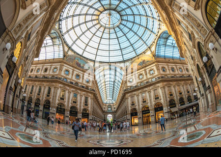 MILAN, ITALY - JULY 16, 2017: Milan city skyline at Galleria Vittorio Emanuele II shopping mall, Milan Italy - Stock Photo