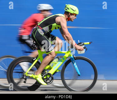 ExCel London, UK, 5th August 2018. Mixed Olympic distance and weekend warrier racers on the cycle route prior to the elite races. The Men's and Women's Elite races attract a high class field of international athletes. Now in its 22nd year, the AJ Bell London Triathlon is the world's largest triathlon, this year welcoming over 10,000 triathletes and elite racers. Athletes will swim, bike and run around the spectacular route in East London in both sprint and Olympic distance categories. Credit: Imageplotter News and Sports/Alamy Live News Credit: Imageplotter News and Sports/Alamy Live News - Stock Photo