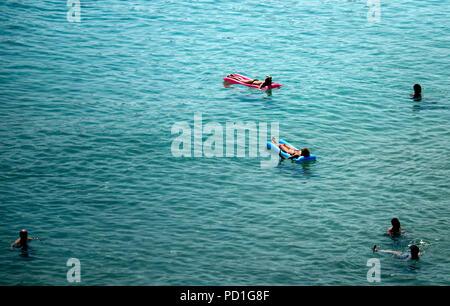 Palma de Mallorca, Spain. 05th Aug, 2018. Tourists bathe in the sea in Playa Mayor. Credit: Clara Margais/dpa/Alamy Live News - Stock Photo