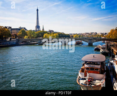 The Eiffel Tower dominates the Paris skyline as seen from the River Seine. - Stock Photo