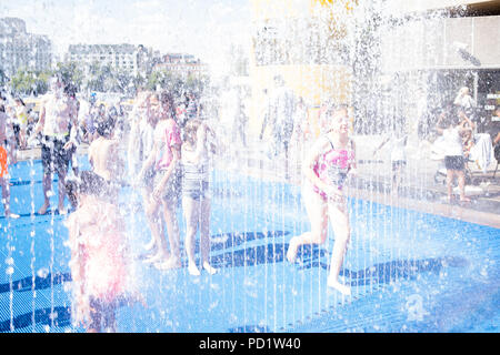 Children have fun and cool off during the summer heat wave in central London - Stock Photo