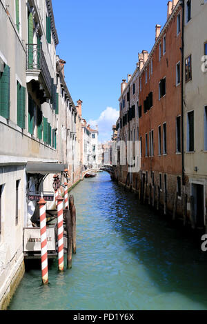 As all good hotels in Venice, Italy, this hotel has an own boat access for guests coming by water taxi or other nautical vehicle - Stock Photo