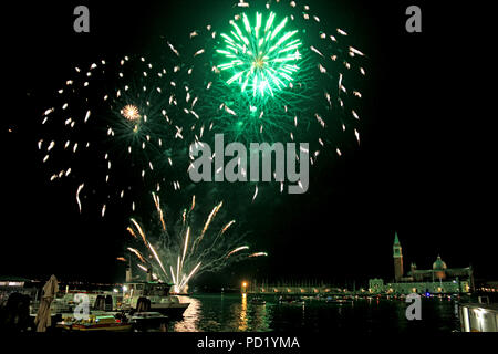 New Year's Eve Firework illuminating the sky around the Venetian Lagoon, Venice, Italy, with the island of San Giorgio Maggiore in the background - Stock Photo