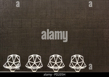 Modern Architecture Details Structure mozaic wall and white design chairs. - Stock Photo