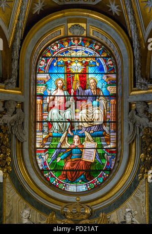 The Trinity in the stained glass of the Church of Santa Maria dell'Anima, in Rome, Italy. - Stock Photo
