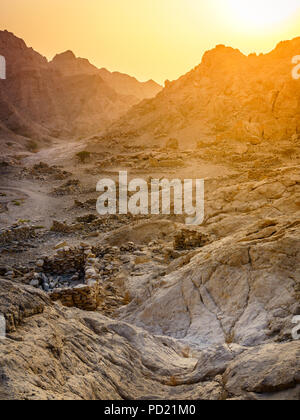 Ruins of an ancient village in the mountains of Ras Al Khaimah, UAE - Stock Photo