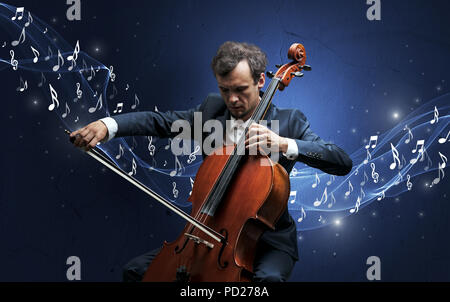 Lonely musical composer with cello and sparkling musical notes around - Stock Photo