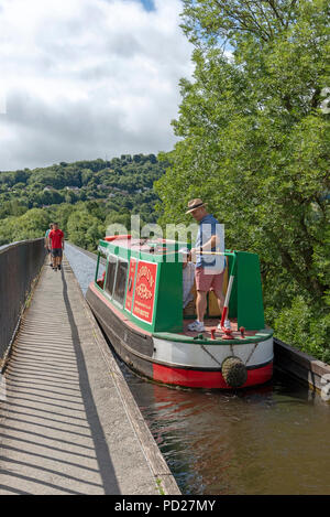 Pontcysyllte Aqueduct over the River Dee at Trevor near Llangollen North East Wales. Man on the tiller of a narrowboat navigating the narrow aqueduct - Stock Photo