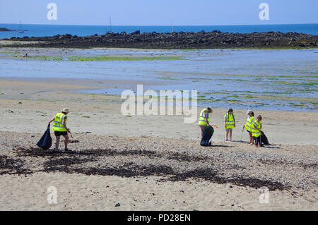 Volunteers cleaning the beach at Marazion, Cornwall, UK - John Gollop - Stock Photo