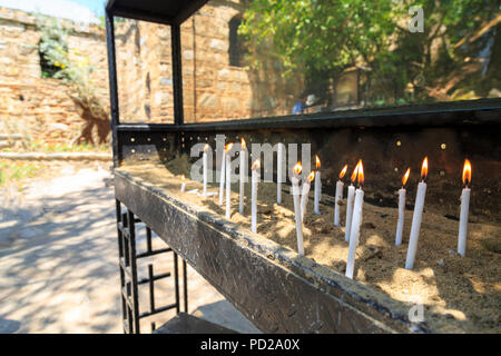 Candles near house of virgin Mary, believed last residence of Mary in Ephesus, Turkey - Stock Photo