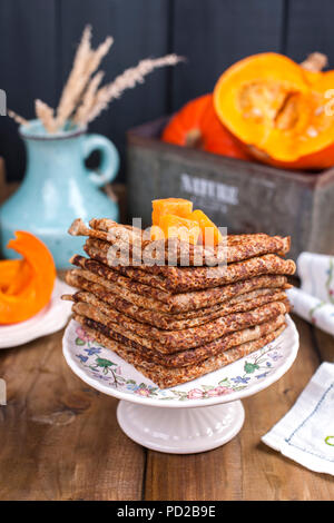 Delicious homemade pancakes for breakfast, with pumpkin and honey. Breakfast for the whole family. Rustic photo. Copy space - Stock Photo