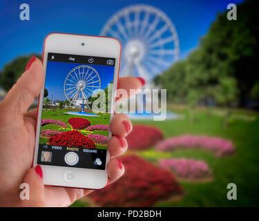 GB - DEVON: Princess Gardens and English Riviera Wheel displayed on an iPhone screen - Stock Photo