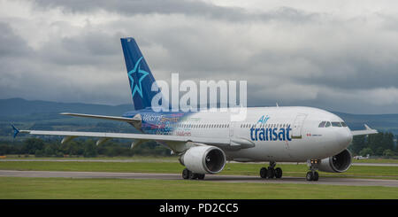 Canadian low cost airline, Airtransat seen at Glasgow International Airport, Scotland - Stock Photo