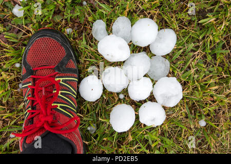 Hailstones from a thunderstorm over Chabanais, France, that turned the sky black and dropped hailstones between golf ball and tennis ball in size. Suc - Stock Photo