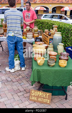 Boca Raton Florida Royal Palm Place farmers market shopping pottery ceramics hand crafted art artist man men sell display table - Stock Photo