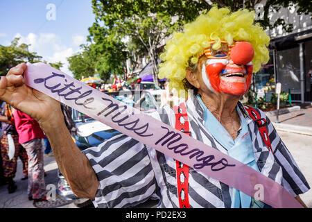 Miami Coconut Grove Florida King Mango Strut annual community event parade satire parody clown senior participant red nose humor - Stock Photo